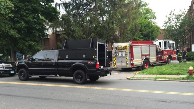 Police swarmed an apartment complex on Collins Street for a drug operation on Thursday. (WFSB)