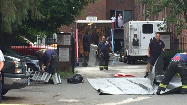Hazmat crews setting up outside of an apartment complex on Collins Street in Hartford. (WFSB)