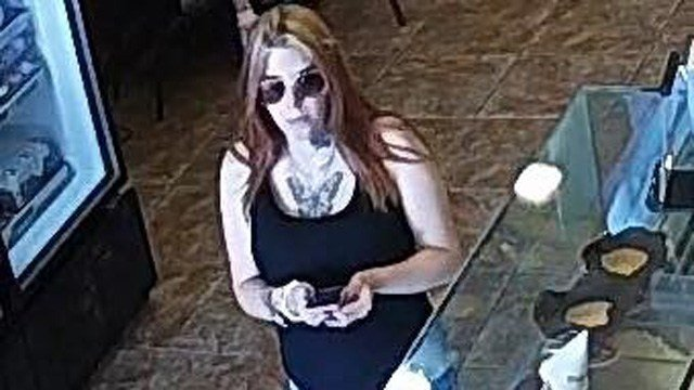 Waterford police said this woman passed a fake $50 bill at an ice cream shop. (Waterford police photo)