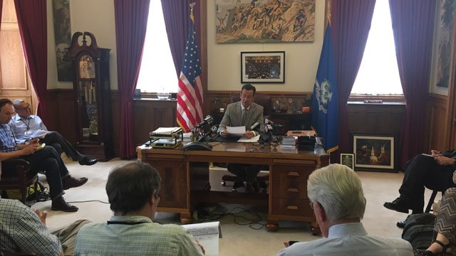 Gov. Dannel Malloy said he is signing an executive order to give the state government moving forward. (WFSB photo)