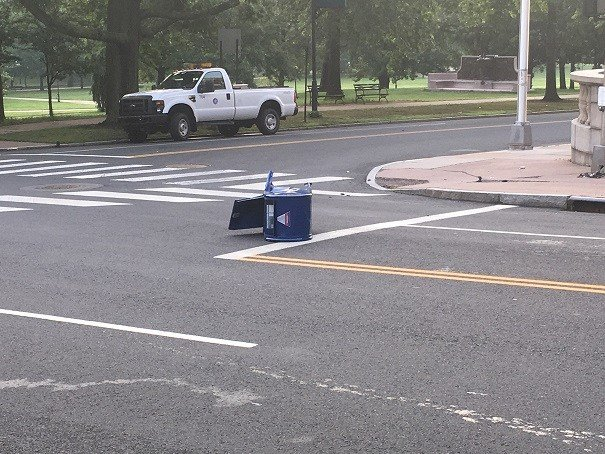 Mailbox lays in the roadway after it was hit and launched a distance.  (WFSB)