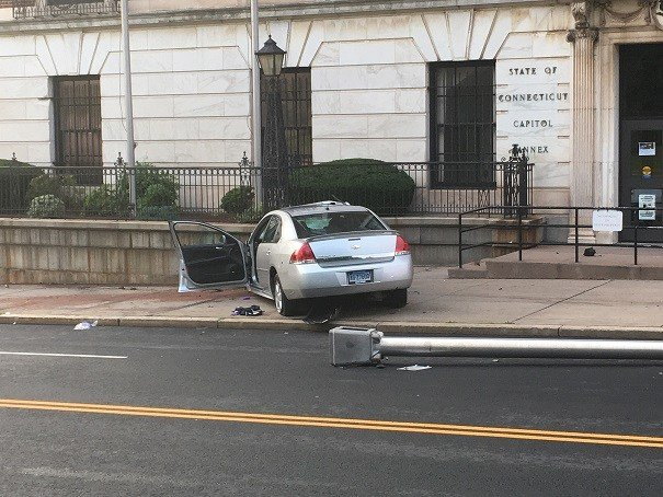 The vehicle also took down a light pole before hitting a wall.  (WFSB)