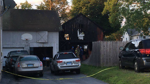 A fire caused heavy damage to a barn and an apartment in Torrington Tuesday morning (WFSB).