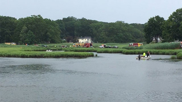 Police and Fire are searching the Branford River following a report of a child missing in the water. (WFSB)