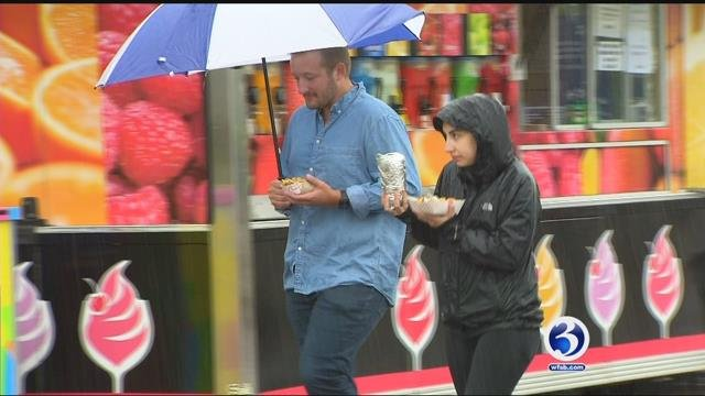 Riverfront Plaza was a bit wet Friday afternoon, but there were still plenty of food trucks and people enjoying their lunch break. (WFSB)