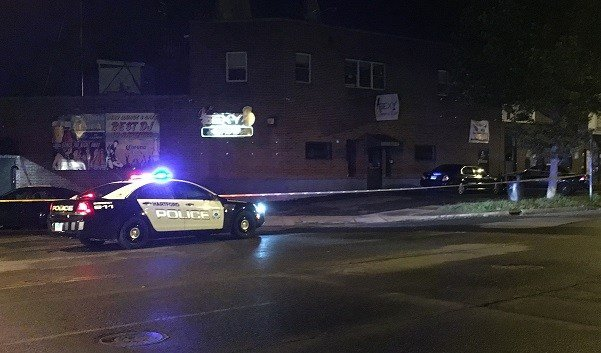 Police and crime tape remain outside the Sexy Lounge on Maple Avenue.  (WFSB)