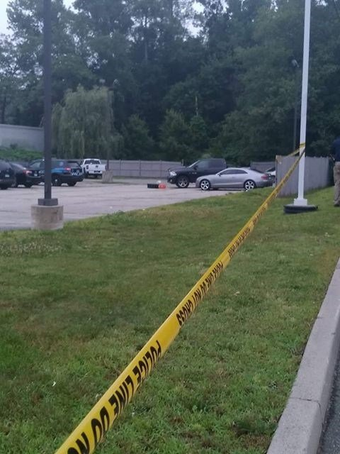 Police tape lines the parking lot of the Ultra Violet club on West Main Street.  (Viewer submitted photo)