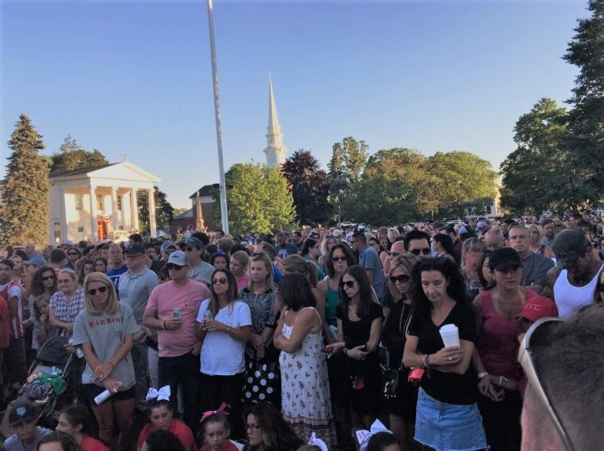 Hundreds gather to mourn the loss of a 10-year-old who drowned in Branford. (WFSB)