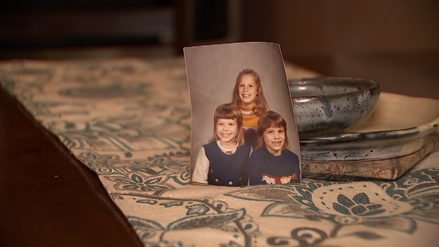 This photo of Tammy, Jackie and Kim DeMars was unearthed during flooding repairs at a home in Granby. (WFSB)