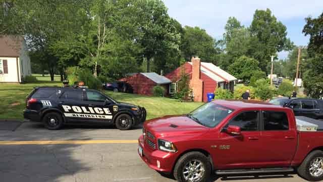 A car slammed into part of a house in Newington (WFSB)
