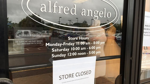 "Alfred Angelo in Manchester has a sign that says ""store closed"" on its front door. (WFSB)"