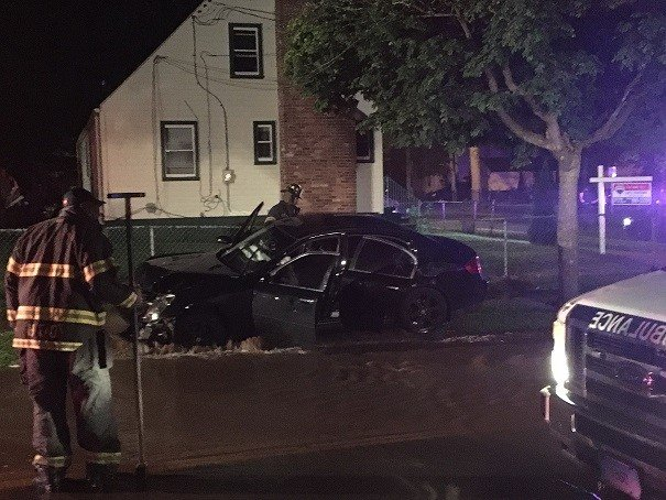 Water fills Burham Street after a car knocked down a hydrant during a crash.  (WFSB)