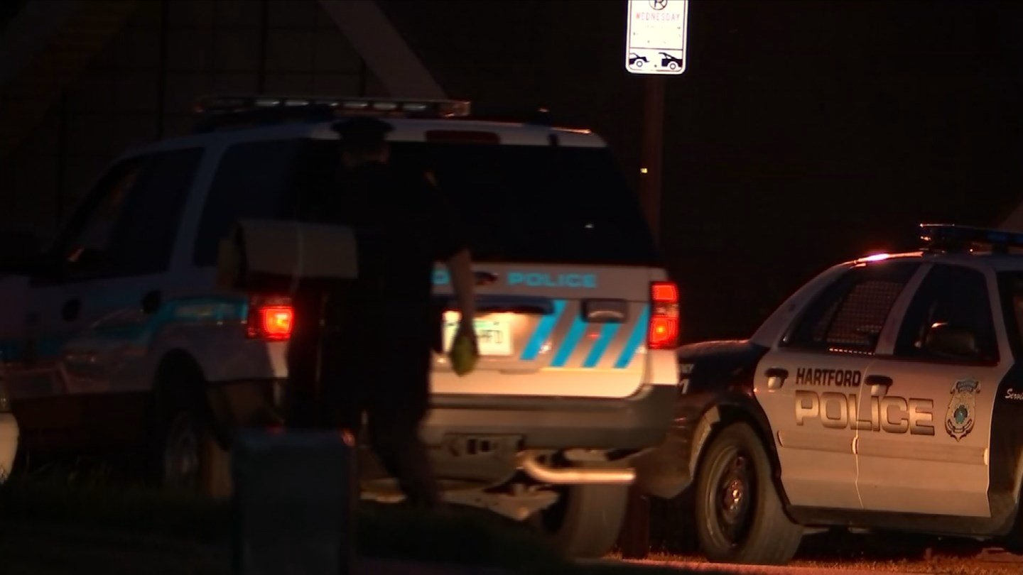 Police cruisers block Coleman Drive as officers investigate a crash early Tuesday.  (WFSB)