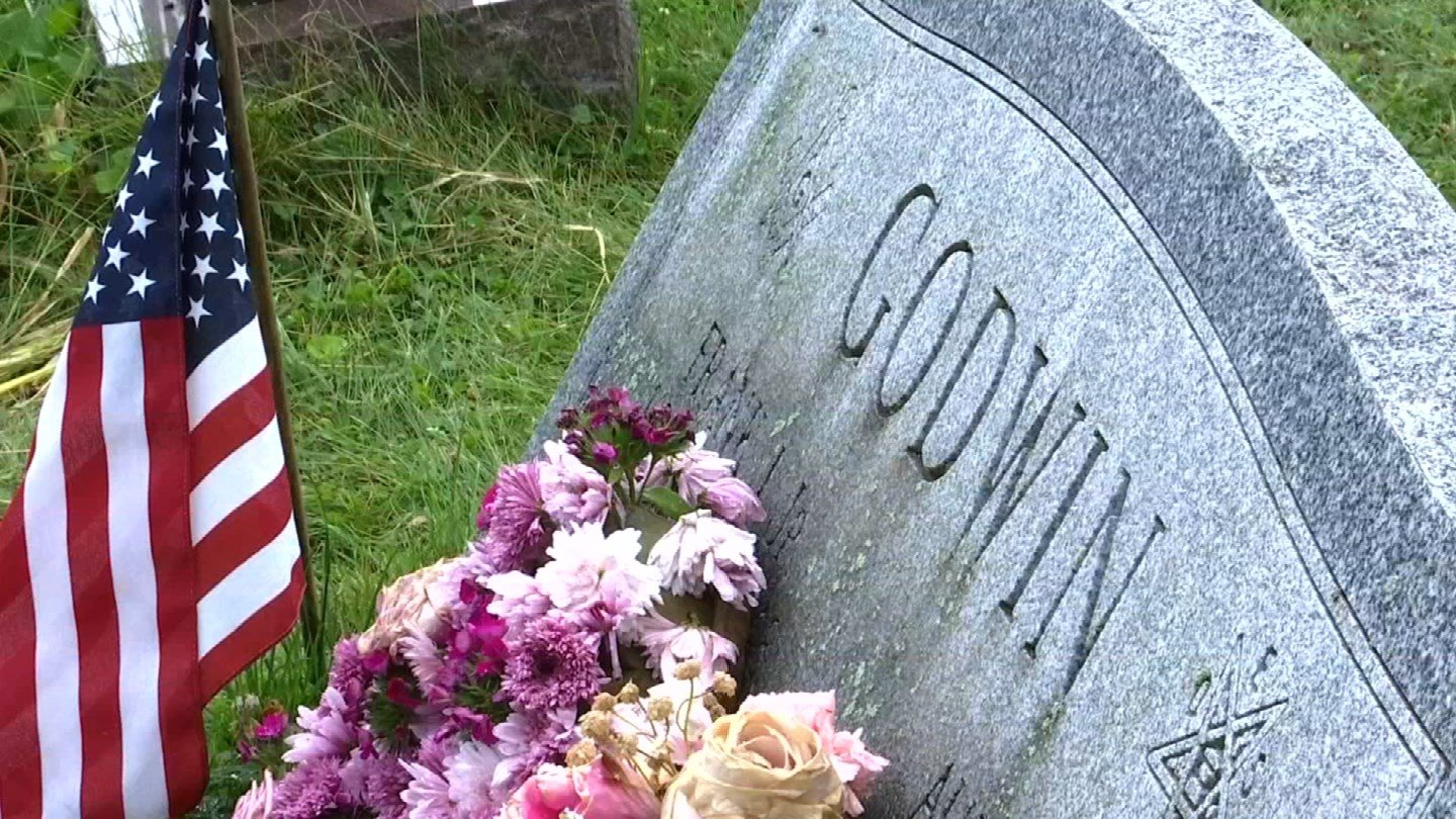 Sharon Godwin Purzycki says someone stole flowers off of her mother's grave site hours after the burial. (WFSB)