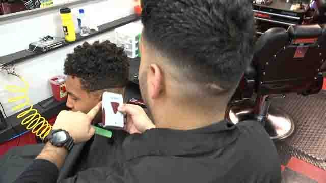 A Meriden barber is motivating students to do better in school (WFSB)