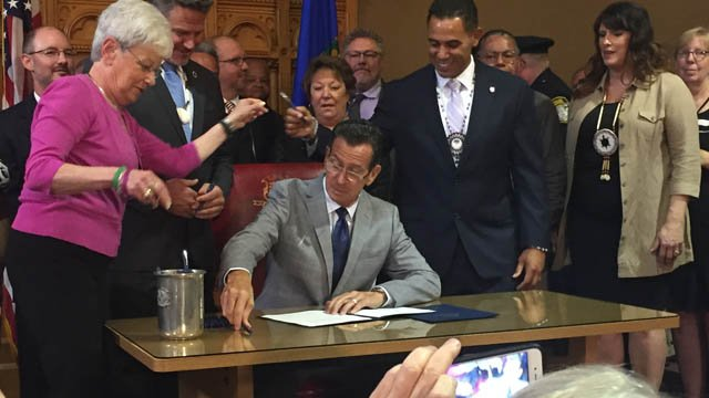 Malloy signs law letting CT tribes build East Windsor casino