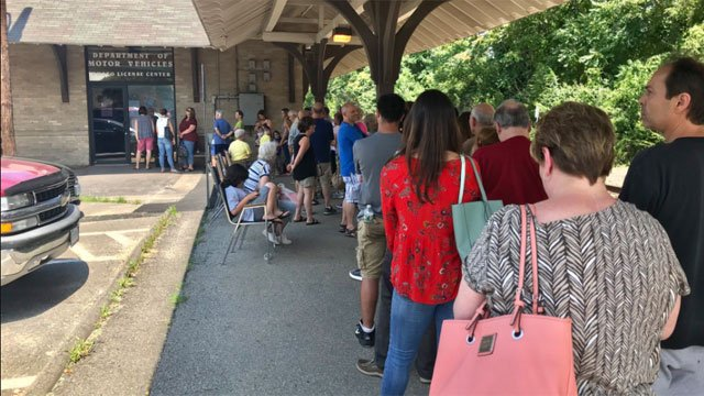 There is a two and half hour wait in the heat the DMV in Derby. There were reports of people fainting this morning. (WFSB)