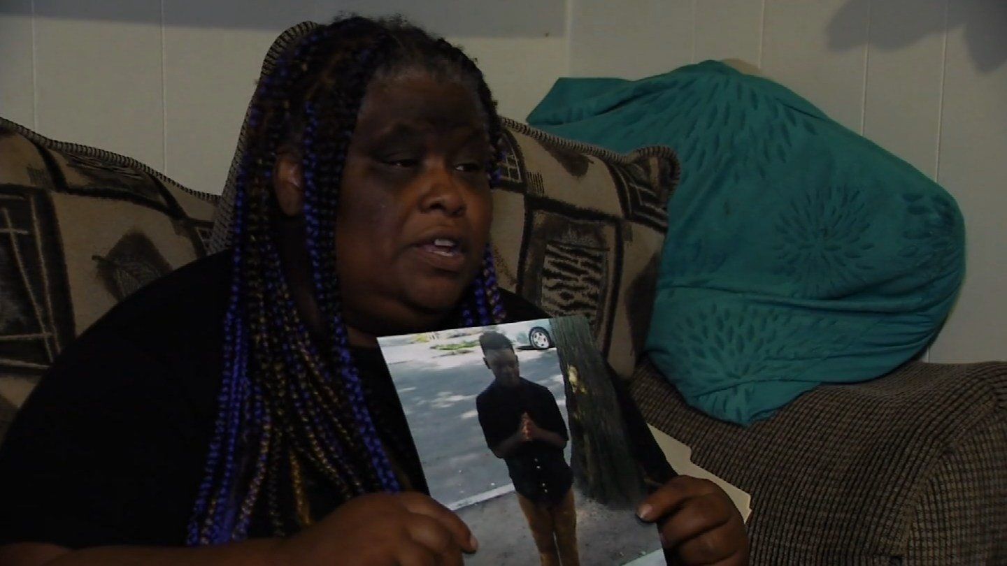 Demethra Telford holds a picture of her son, Tyrick Keyes, who was killed in a shooting last week in New Haven. (WFSB)