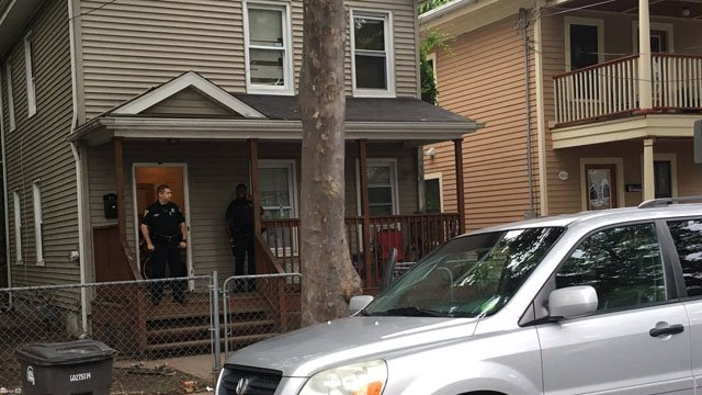 Investigators swarmed a home on Lilac Street in New Haven on Tuesday morning. (WFSB)