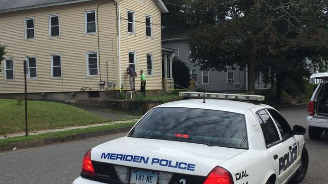 Police were seen investigating at a home in Meriden as well (WFSB)