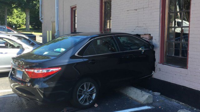 Car crashes into Styles Salon on Wednesday morning. (Milford Police Department)