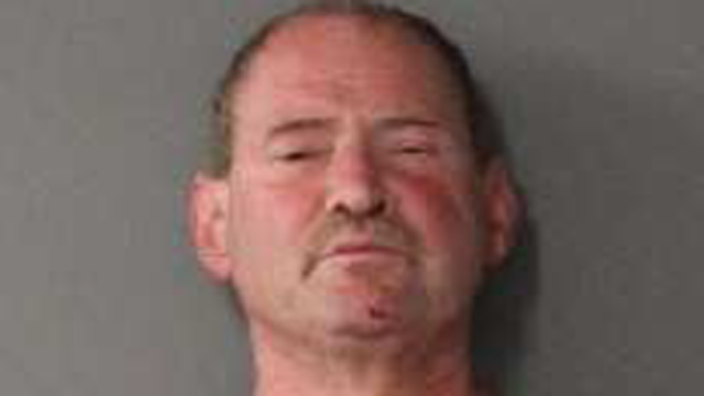 Robert Murphy faces a list of charges after holding a woman at knife-point in a wooded area of New Hartford, according to state police. (State police)