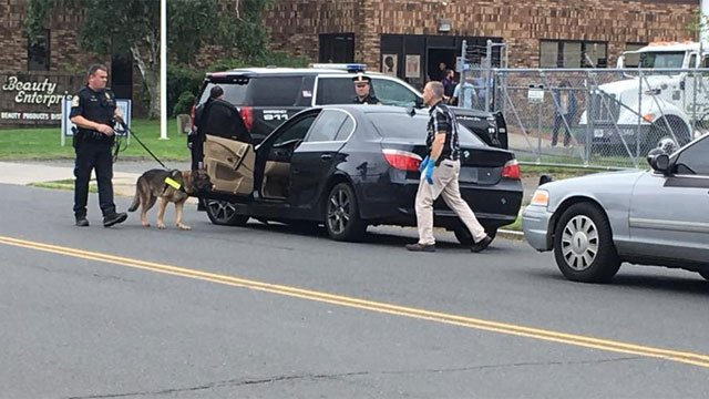 Police dog gets scent inside car to find suspect(s). Officers are searching now in Hartford. (WFSB)