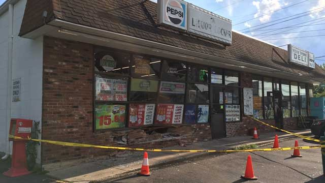 A car hit a liquor store in Newington on Monday (WFSB)