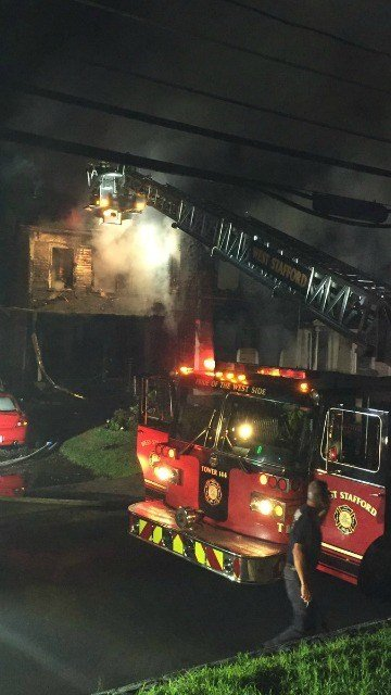 Firefighters battle a fire in Stafford Thursday morning (Courtesy:Manchester Fire Rescue EMS Dept).