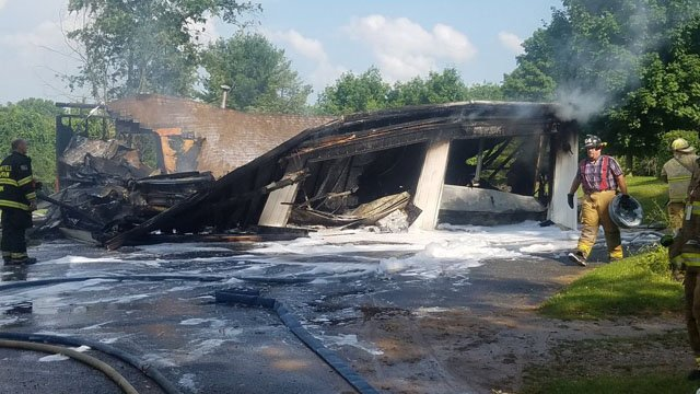 Norfolk firefighters worked to put out a garage fire Friday. (Norfolk Fire Department)