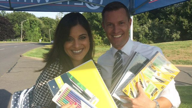 Eva Zymaris and Eric Parker show off the school supplies donated to our drive. (WFSB)