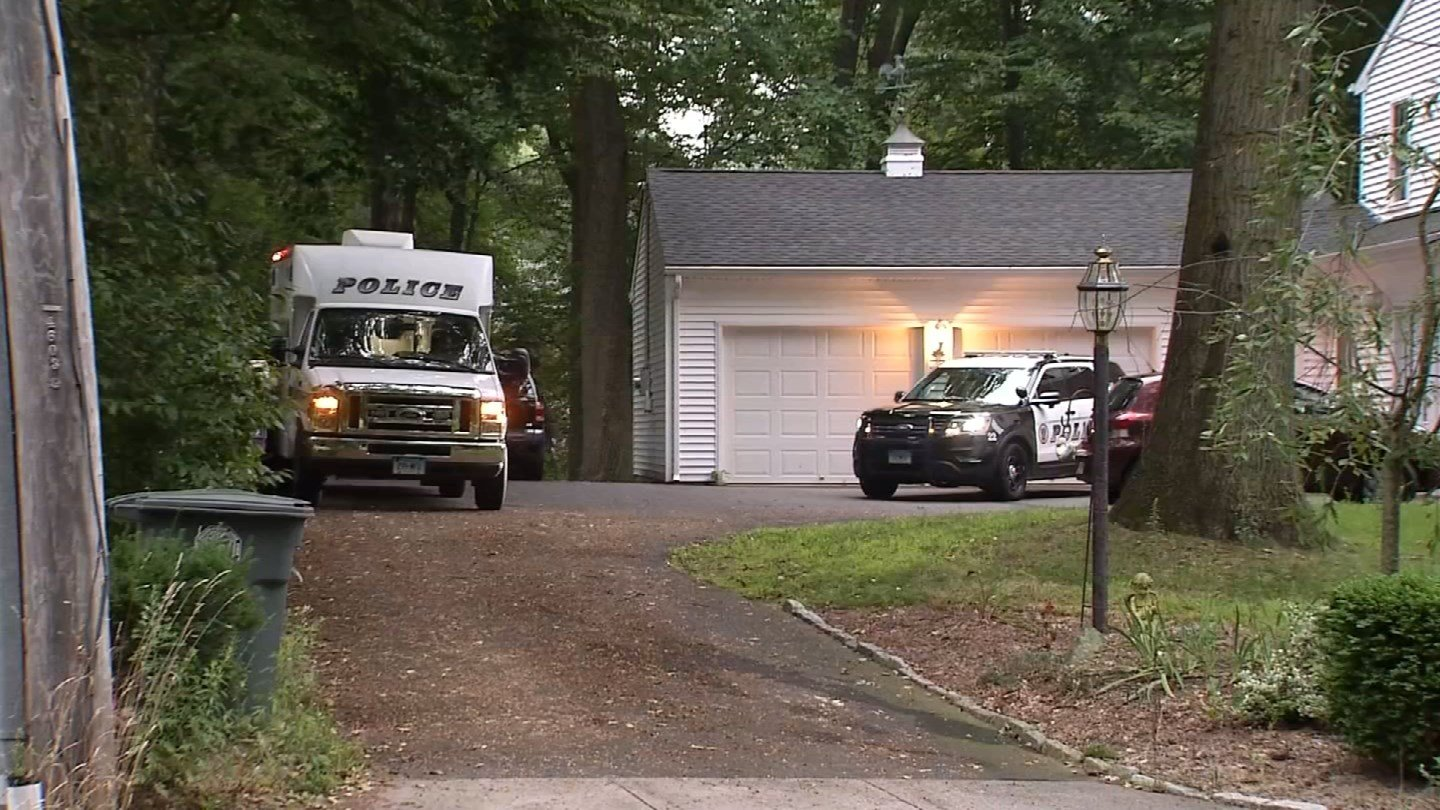 A crime scene unit and a police cruiser were parked outside of a home on East Rutland Road Tuesday for an investigation. (WFSB)