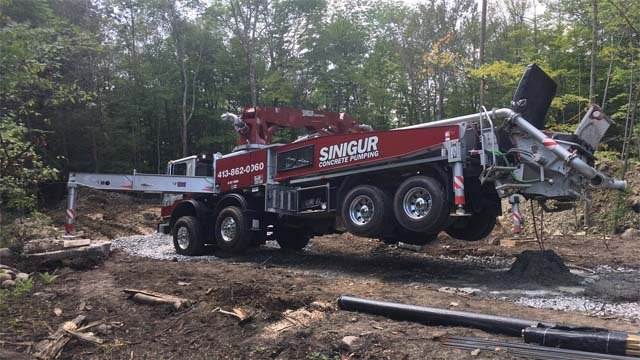 A man was injured after being hit by a concrete pumping truck arm in Goshen (WFSB)