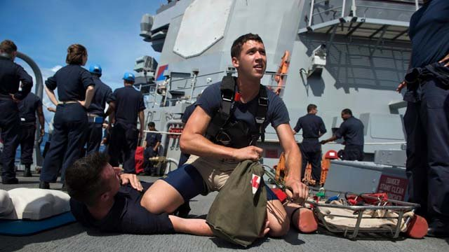 Electronics Technician 3rd Class Dustin Doyon provides first aid assistance during seamanship drills while serving as Search and Rescue Swimmer onboard the Arleigh Burke-class missile-guided destroyer USS John S. McCain (DDG 56). (USS John S. McCain)