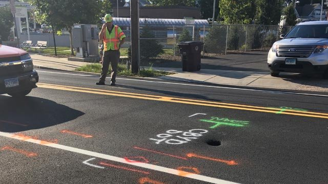A small sinkhole closed a portion of East Main Street in New Britain on Thursday morning. (WFSB)