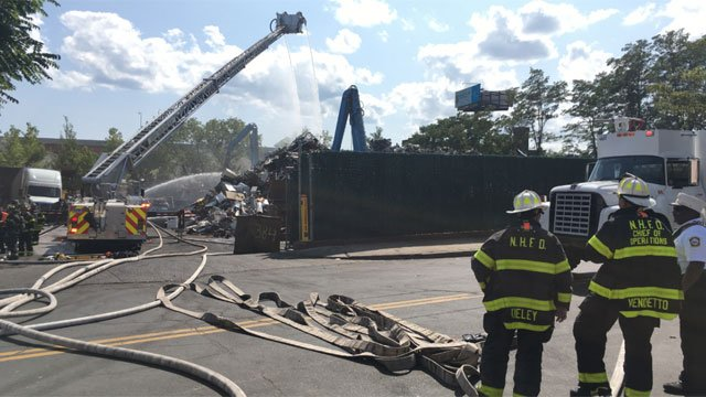 Firefighters knocked down a fire at a scrapyard in New Haven. (WFSB)