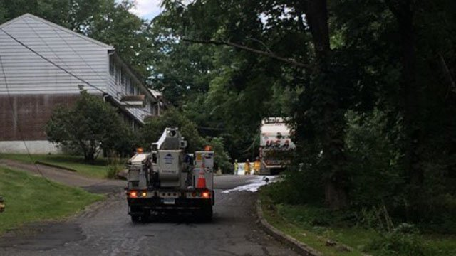 A garbage truck was trapped by downed wires in Vernon on Friday. (Vernon police)
