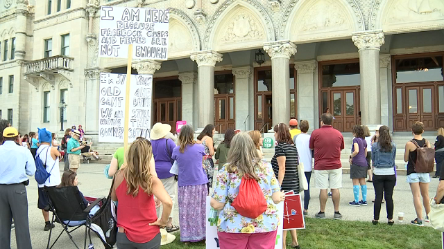 Dozens of women took the Capital Steps on Saturday to raise awareness for issues, they said, women still face. (WFSB)