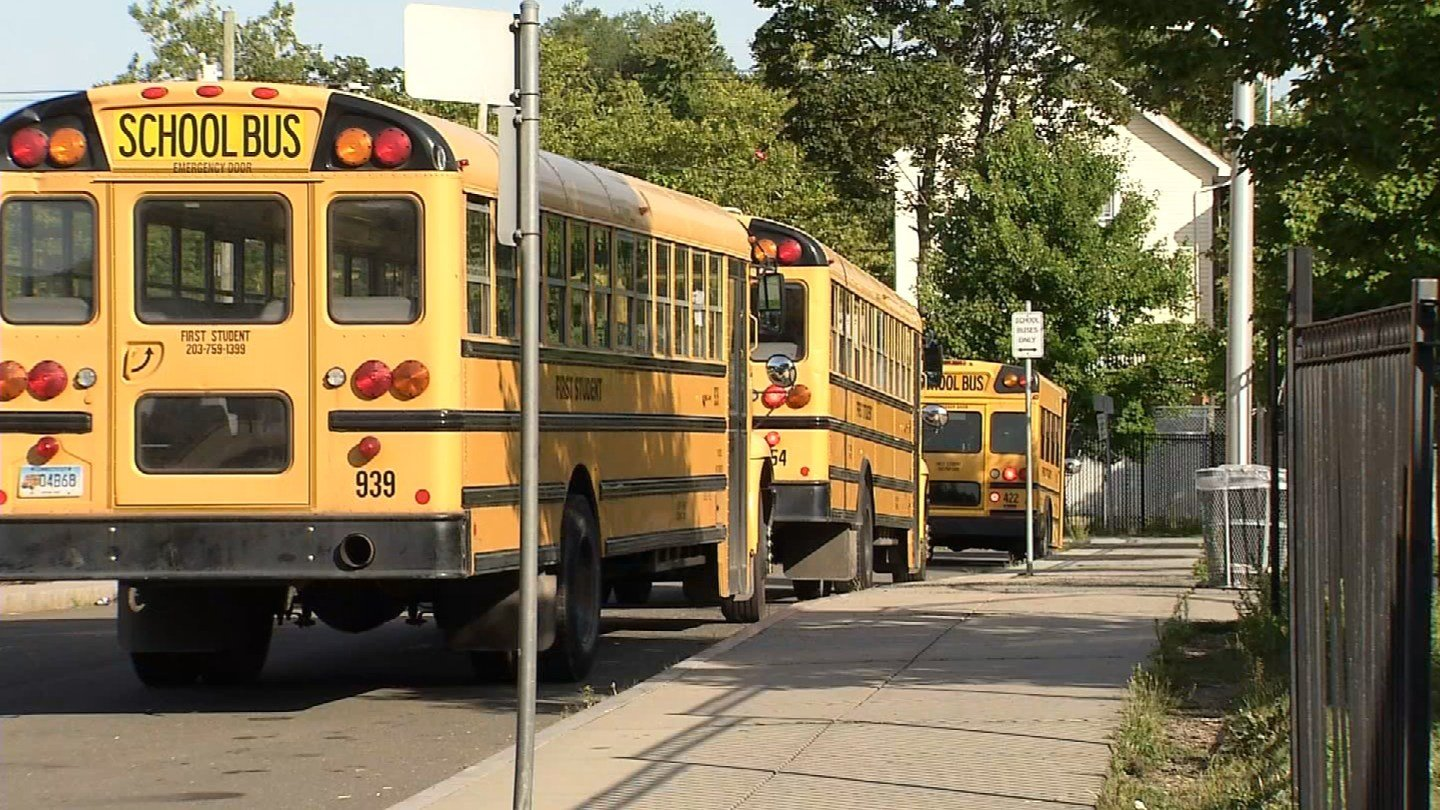 School buses lined up outside of the John C. Daniels School in New Haven. (WFSB)