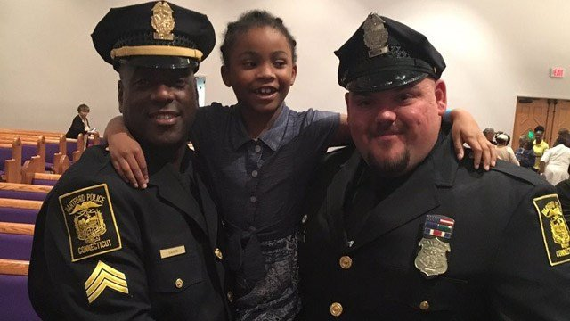 Rosalyn Baldwin hugs two Hartford officers during her mission to hug officers in all 50 states. (Deputy Chief Brian Foley)