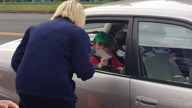 Irene O'Connor accepts a donation during Channel 3's Help for Houston fundraiser on Wednesday. (WFSB)
