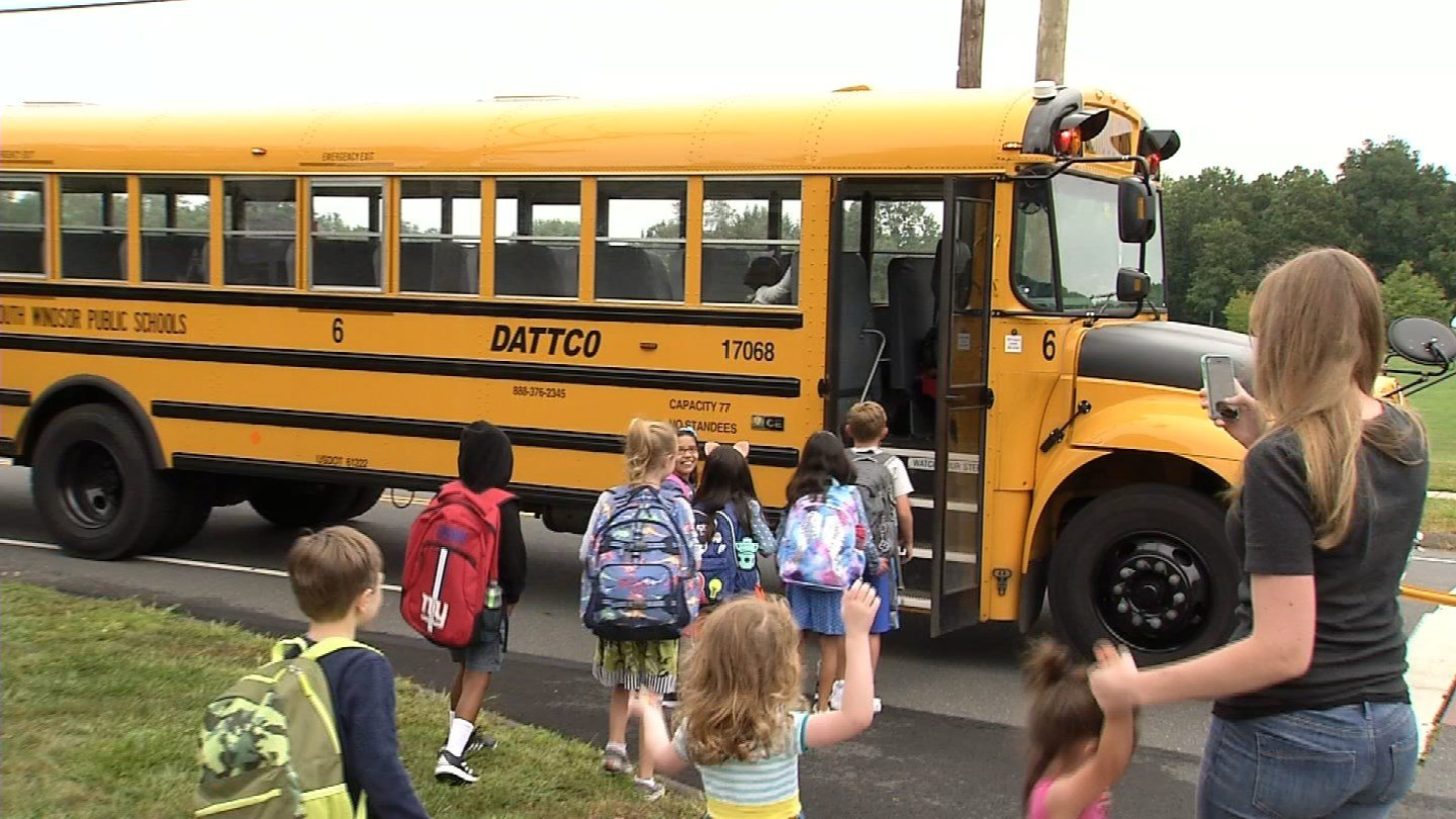 Children hop on a bus in South Windsor for their first day of school on Wednesday. (WFSB)
