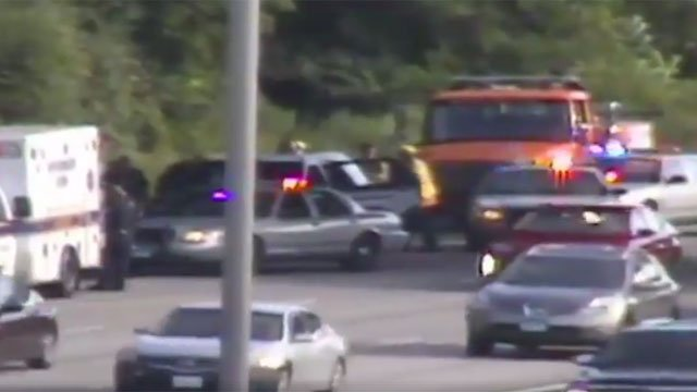 An unidentified man gets out of his vehicle on I-91 in Windsor. (CT DOT)