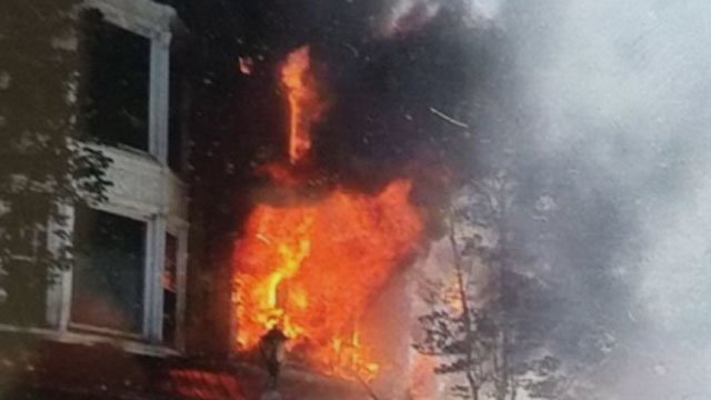 Flames shot out of the building on Orange Street on Friday. (iWitness)