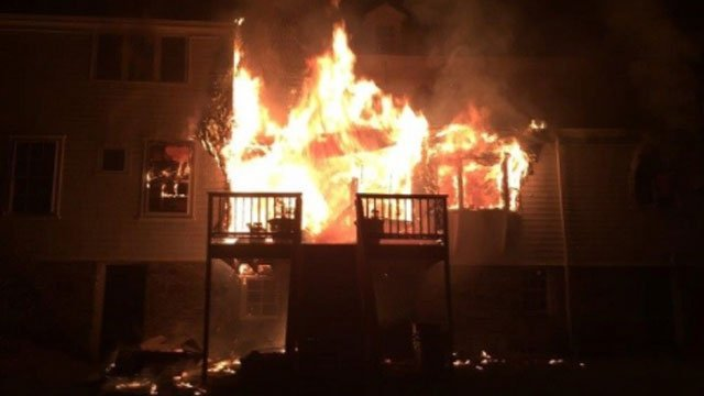 Flames shoot from a home on Old Post Road in Fairfield.  (Fairfield Fire Department)