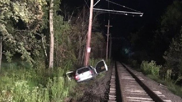 Police said the car ended up 200 feet down the tracks before crashing. (East Windsor Police Dept. Facebook)
