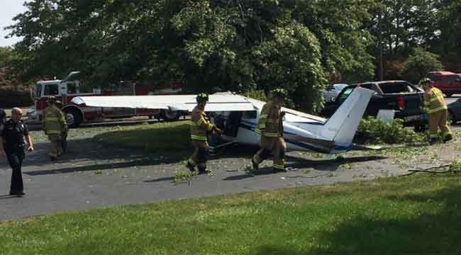 A plane lands in Carling Technologies parking lot (Tracy Pasniewski)