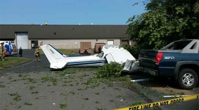 A plane crashes in Carling Technologies parking lot in Plainville. (Viewer photo)