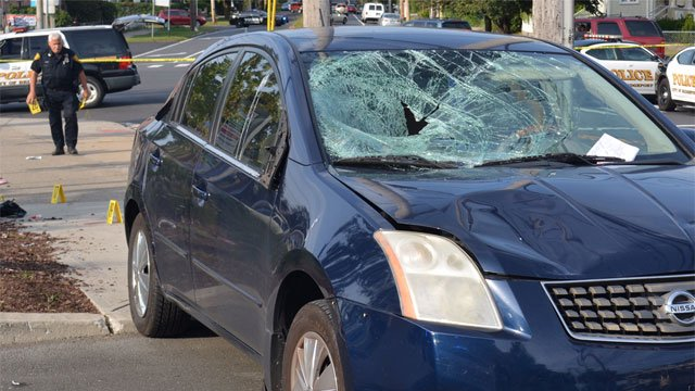 Two crossing guards were struck by a motor vehicle in Bridgeport on Tuesday morning. (Bridgeport Police Department)