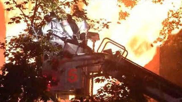 Flames seen shooting from a building on Gillett Street. (WFSB)